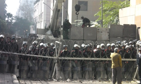 New walls built around interior ministry as clashes continue